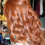 back view of girl with long red hair curled