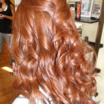 long red hair curled and partially pinned back