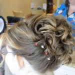 back view of updo with curls and bobbypins