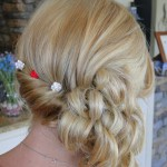 blonde hair swept to side pinned and cascading curls