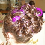 back view of curly updo with purple strands incorporated