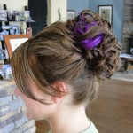 side view of updo with curls and some purple color