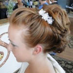 side profile of updo hairstyle done in salon