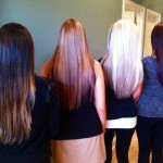 four different color womens hair from behind with ombres
