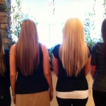 four women standing back to with long straight hair with ombres