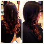 back and side profile of long brunette curled hair with ombre